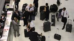 Passengers arrive at check-in counters at Suvarnabhumi Airport . Bangkok Stock Footage