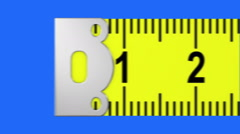 Tape measure on a blue screen Stock Footage