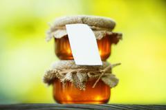Jars of honey in eco-style Stock Photos