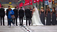 Photographer and wedding party in an urban setting Stock Footage