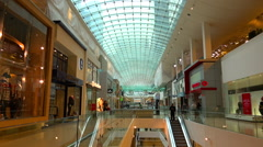 Interior of massive Glass roof mall Stock Footage