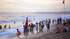 Crowd of tourists and surfers relaxing on a beach. Kuta Beach Stock Footage