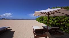 Deck chairs with umbrellas. Beach view. Boat on a beach. Nusa Dua beach Stock Footage