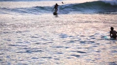 Surfers in the Ocean. Tourists relaxing in water. Kuta Beach Stock Footage