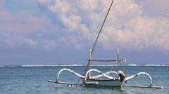 Traditional balinese trimaran in the ocean. Nusa Dua beach Stock Footage