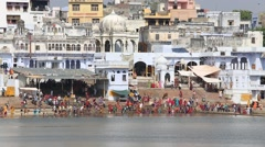 People at ritual washing in the sacred Sarovar lake. Pushkar, India Stock Footage