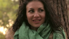 Flirty girl playfully looks through eyes in different directions Stock Footage
