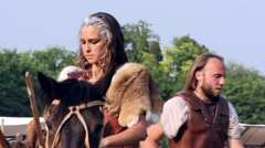 Beautiful Girl Riding a Horse at a Historical Reenactment Stock Footage