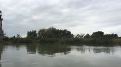 Passing by in Danube Delta the old lighthouse Stock Footage