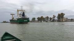 Big cargo ship in the Danube Delta leaving Sulina Stock Footage
