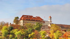 Autumn forest with building placing on hill in Brno, Czech Republic Stock Footage