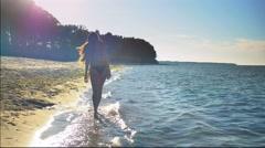 Girl Walking on the Beach Stock Footage