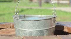Concepts and ideas Preservation of environment. Well. Bucket of clean water Stock Footage