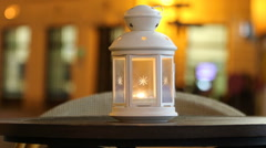 Icing lamp on the table on blurred house background in old centre of Bratislava Stock Footage