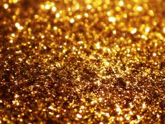 Christmas gold background. Golden holiday glowing glitter background Stock Photos