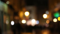 People walking on the holiday street at nightly city, defocused view Stock Footage