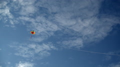 Lightweight toy kite flying in sky Stock Footage