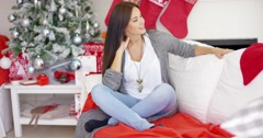 Cheerful woman in a festive Christmas home Stock Footage