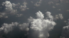 Thick clouds seen through the airplane window above the ground Stock Footage