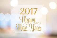 Happy New year 2017 word on white frame at abstract blurred bokeh light backg Stock Illustration