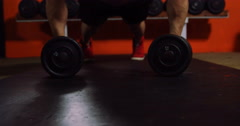 Muscular man performing push-up exercise with dumbbell Stock Footage