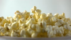 Pouring fresh popcorn into paper box. Cinema, overflow or fast food concepts Stock Footage