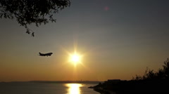 The Plane goes down over the Sea at Sunset Stock Footage
