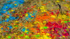 Colorfull powder on the ground - handheld Stock Footage