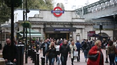 Crowds od commuters: Embankment train station in London Stock Footage