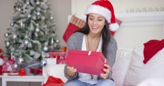 Excited young woman opening a Christmas gift Stock Footage