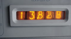 The vacuum tube display on the device counts seconds. Close up. Stock Footage