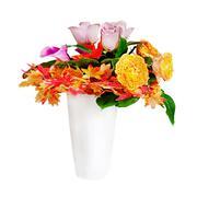 Floral bouquet arrangement centerpiece in white vase isolated on white backgr Stock Photos