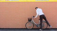 Mounting a Bike and Riding Away Stock Footage