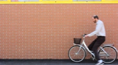 Leaning a Bike against a Brick Wall Stock Footage