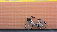 Carrying a Bicycle Away Stock Footage