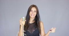 Vivacious woman having fun at a New Year party Stock Footage