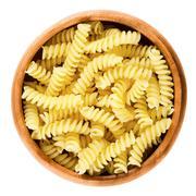 Girandole torsades pasta in wooden bowl over white Stock Photos