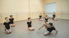 Dancer is doing exercises in ballet class Stock Footage