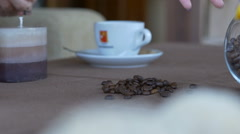 Pours out grains of coffee on a brown table Stock Footage