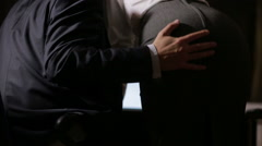 Sexual relations at work. Young business couple are having sex in the workplace. Stock Footage
