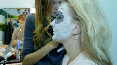 Make-up artist and stylist doing makeup model for Halloween Stock Footage