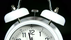 Old-fashioned copper alarm clock rings Stock Footage