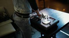 Female hands of DJ tweak track controls on dj's deck, camera is breathing Stock Footage