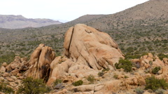 Zoom Out  - Large Finger Rock in the Mojave Desert - California Stock Footage