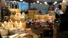 Many pieces of cheese and salami on the counter. Stock Footage
