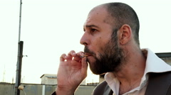 confident man and nervous smoke a cigarette on the terrace Stock Footage