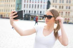 Girl take selfie in Dresden Stock Photos