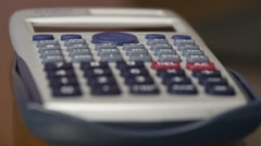 Calculations Using Calculator And Pencil Stock Footage