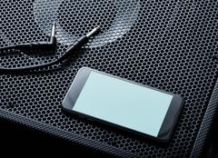 Mockup of black modern smartphone turned left. Clipping path Stock Photos