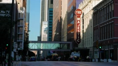 Dallas street traffic time-lapse w/ Landmark Majestic Theater Marquee sun Lit Stock Footage